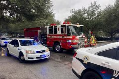 Firetruck and police cars respond to a car accident.