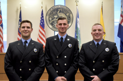 Three firefighters posing for photo.
