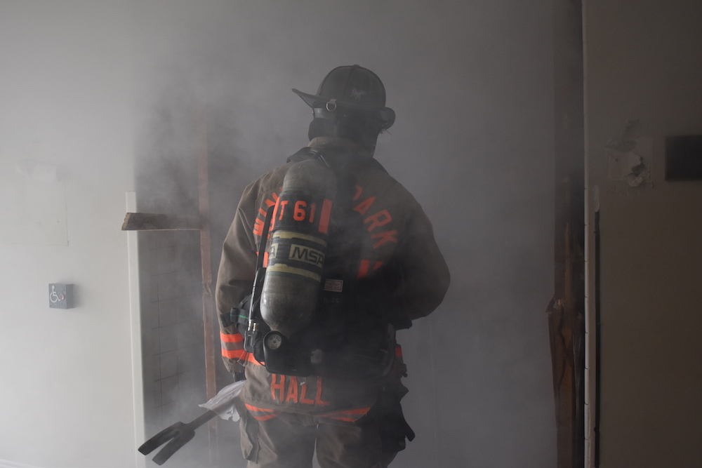 Firefighter in smokey building