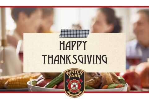 Happy Thanksgiving written on a sticky note across a family eating a Thanksgiving turkey with the WPFD logo at the bottom.