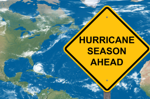 Hurricane season ahead yield sign on top of a map with a hurricane brewing off the coast of Florida